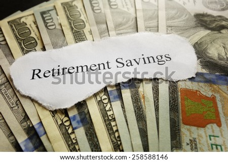 Retirement Savings paper scrap on cash                                - stock photo