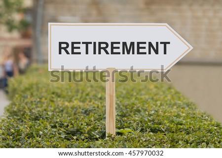 retirement signpost - stock photo