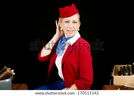Retro Airline Stewardess or Attendant Primping at her Vanity. - stock photo