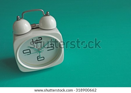 Retro alarm clock isolated on mint green background with copy space. Vintage effect. - stock photo