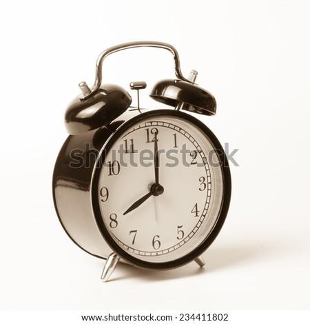 Retro alarm clock isolated on white background - stock photo