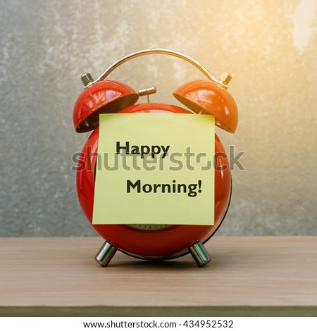 Retro alarm clock on grunge background with word good morning. - stock photo