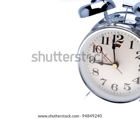Retro alarm clock on plain background