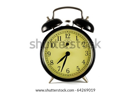 retro alarm clock on the white background - stock photo