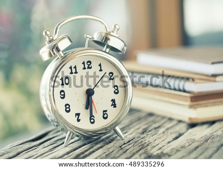 Retro alarm clock with space for text on table - vintage effect style.