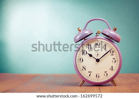 Retro alarm clock with ten minutes past ten o'clock - stock photo