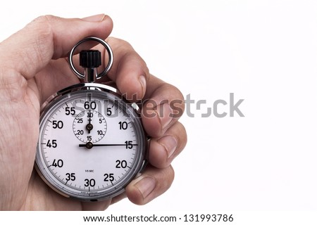 Retro analog stopwatch in a hand pointing on 15 seconds isolated on white background - stock photo