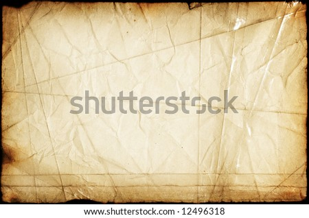Retro artistic paper background with many folds, cuts, dark borders, stains. Fine artistic texture stitched with sticky tape - stock photo