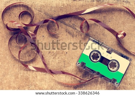 Retro audio cassette with pulled out tape. Vintage image. - stock photo