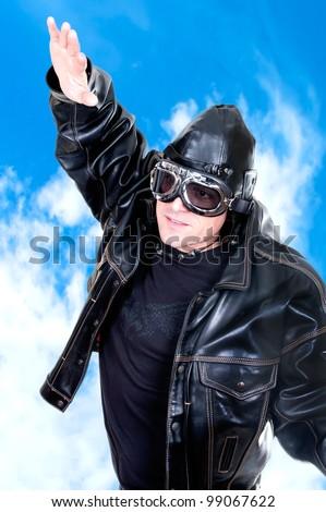 retro aviator on blue sky - stock photo