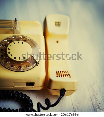 Retro background with telephone on wood table - stock photo