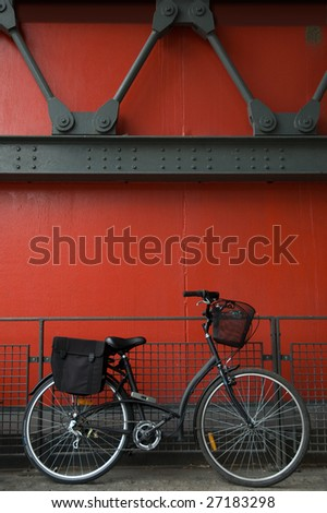 Retro bicycle against a 19 century urban environment - stock photo