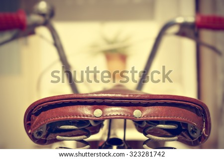 Retro bicycle saddle detail seen from behind. Vintage style. Horizontal image.