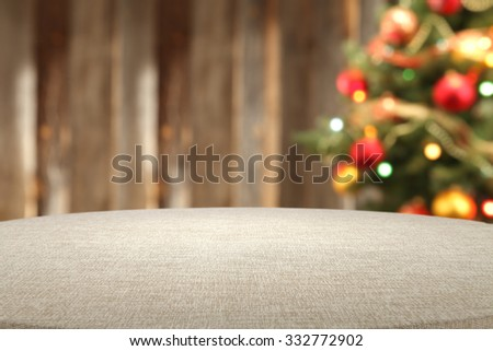 retro big wooden table and xmas tree  - stock photo