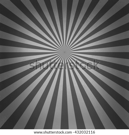retro black and white starburst pattern, old abstract background design, radial lines with bright center and dark border  - stock photo