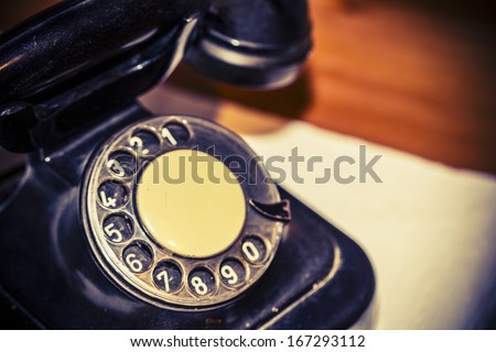 Retro black old phone on the table - stock photo
