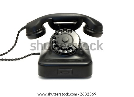 Retro black telephone isolated on white