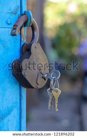 retro blue lock on the door - stock photo