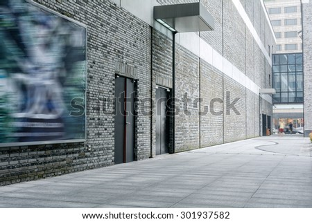 Retro brick wall and empty road in modern city