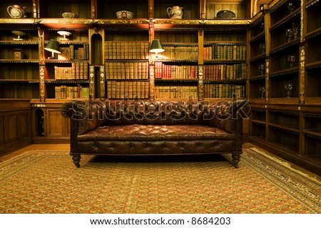 Retro brown leather couch, lounge sitting room - stock photo