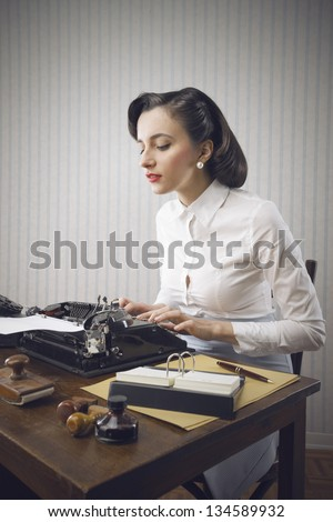 Retro business woman typing in her office - stock photo