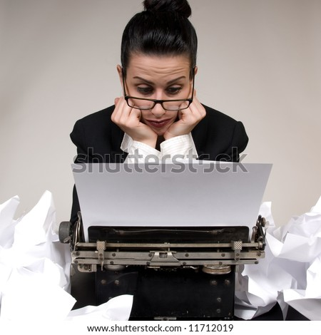 Retro business woman with vintage typewriter - stock photo