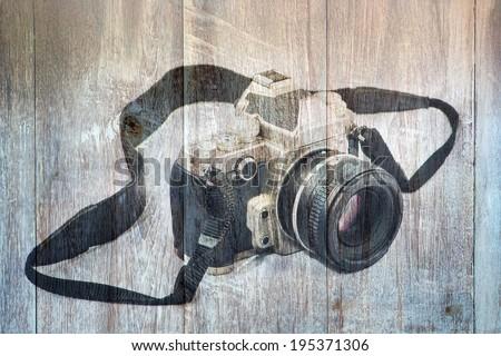 Retro Camera + Wood Background - stock photo