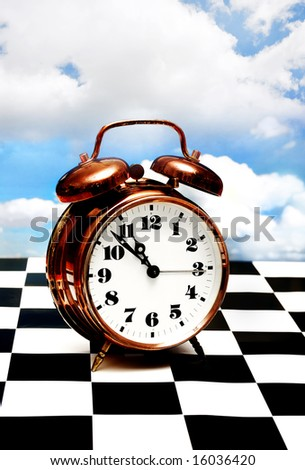 retro clock standing on a chess board with a blue sky in background