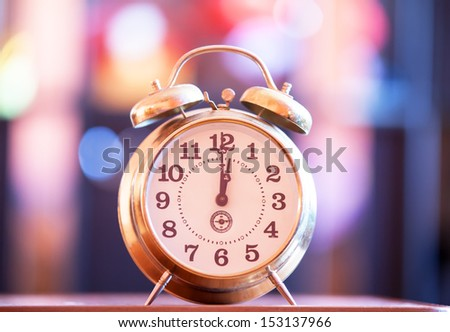 Retro clock with bokeh at background - stock photo