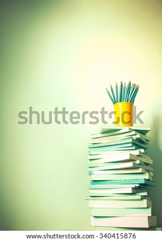retro color tone of Close up book stacked  with the  concrete wall background - stock photo