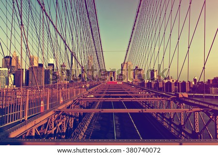 Retro Color View of Deserted Brooklyn Bridge with Detail of Girders and Support Cables Looking Toward Manhattan City Skyline at Sunset, New York City, New York, USA - stock photo