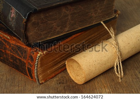 Retro composition with books and paper on wooden background - stock photo