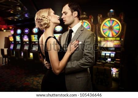 Retro couple against slot machines - stock photo