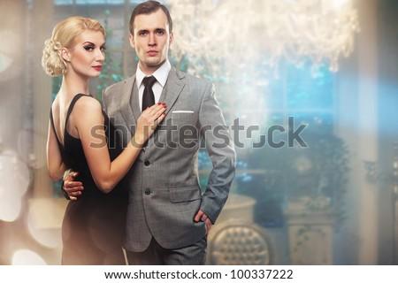 Retro couple in luxury interior. - stock photo
