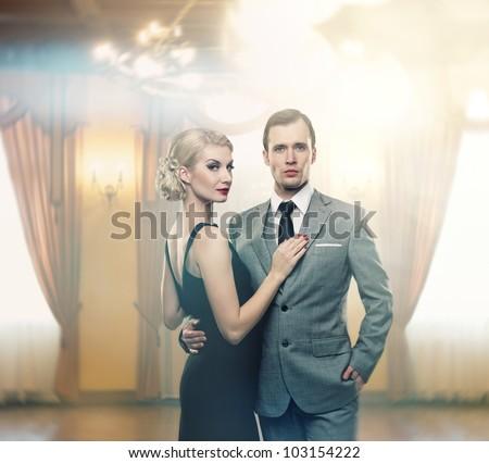 Retro couple in luxury interior - stock photo