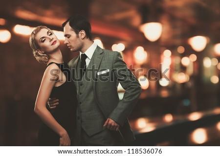 Retro couple over blurred background - stock photo