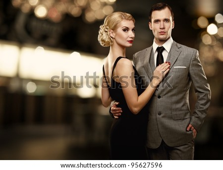 Retro couple over blurred background. - stock photo