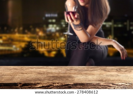 retro desk space and woman with glass of wine in hand