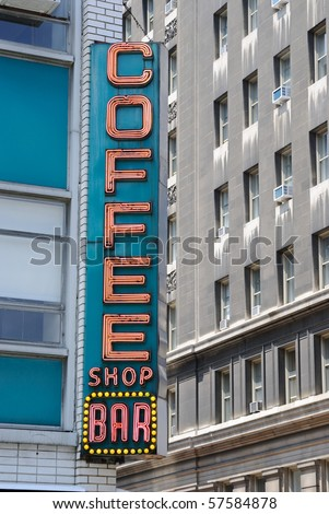 "Retro diner sign in the city saying ""coffee shop bar."" - stock photo"