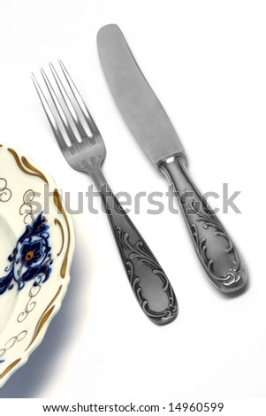retro dish with fork and knife isolated on white background food industry concepts
