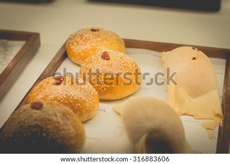 Retro effect faded image of fresh bread (selective focus) - stock photo