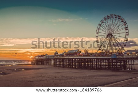 Retro Effect Photo Filter: Blackpool Central Pier and Ferris Wheel, Lancashire, England, UK - stock photo