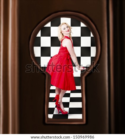 Retro fashion portrait of a stylish sensual pinup girl dancing in bright red dress. Image view through door keyhole - stock photo