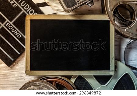 Retro film accessories with blank blackboard for copyspace - stock photo
