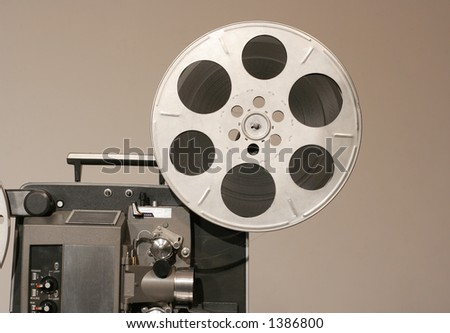 Retro Film Projector front from side with metal reel - stock photo