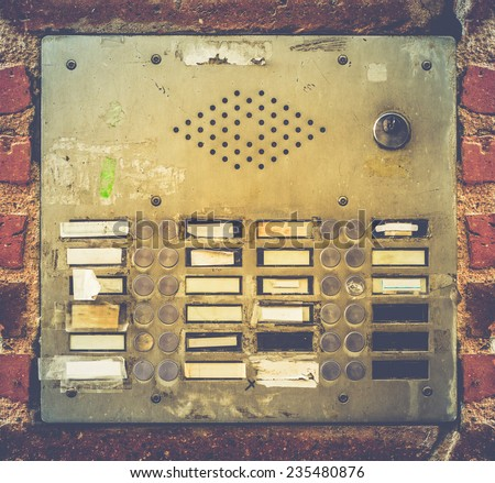 Retro Filter Photo Of Grungy Old Apartment Buzzer Or Intercome Buttons In Toulouse, France - stock photo