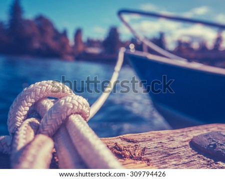 Retro Filtered Photo Of A Luxury Yacht Tied To Pier - stock photo