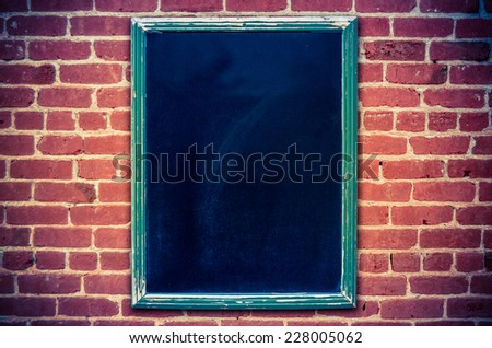 Retro Filtered Photo Of A Restaurant Menu Blackboard On A Red Brick Wall (With Copy Space) - stock photo