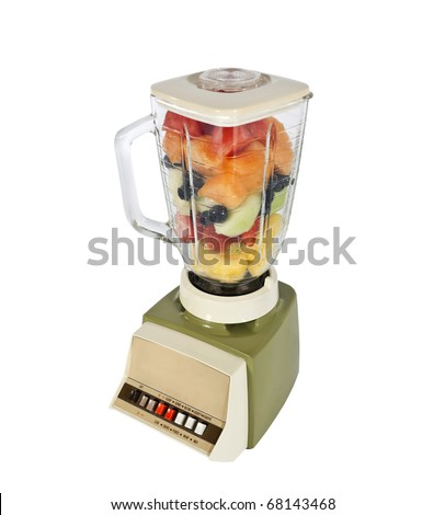 Retro fruit and mellon filled blender ready to rip. - stock photo