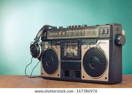 Retro ghetto blaster cassette tape recorder front mint green background - stock photo